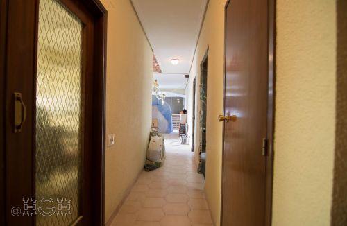 Vista general del pasillo con comedor salón al final, para su nueva distribución de la reforma integral en Avenida Blasco Ibáñez, Zona Mestalla, Valencia. Reforma de Global Home Happiness.